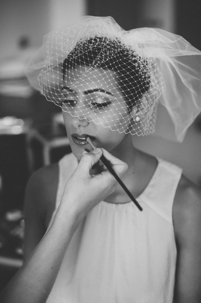 Classic look photo of Bride having makeup put on