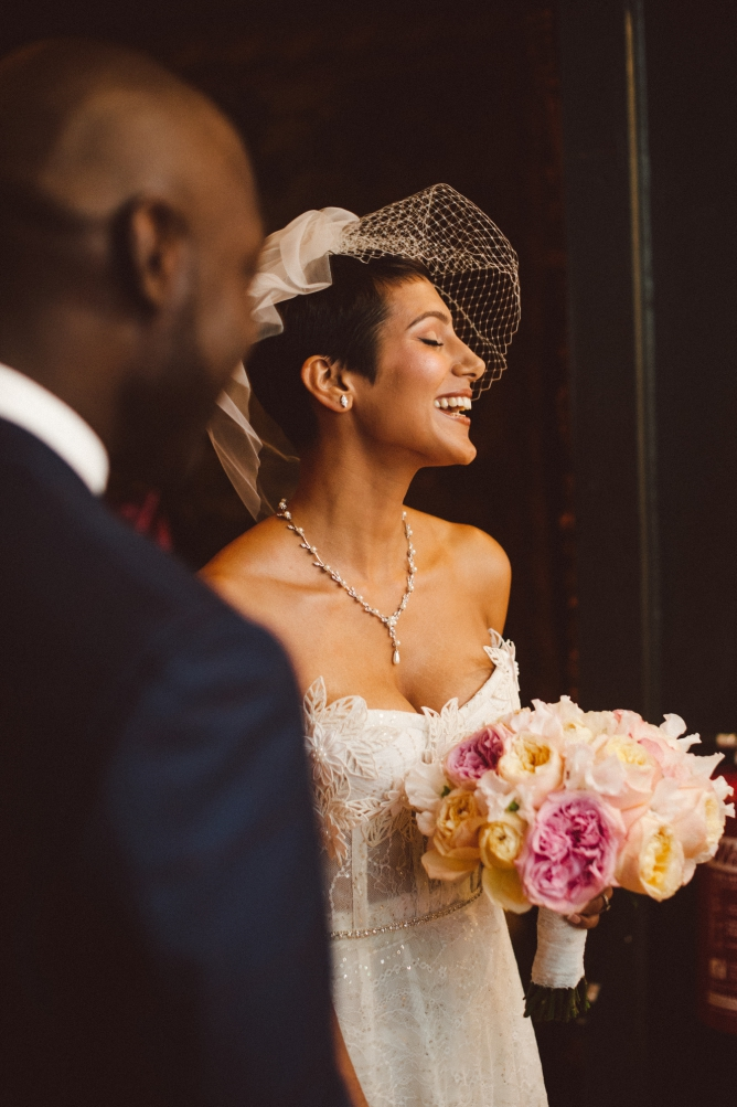 Bride laughing during wedding at Porchester Hall wedding in London