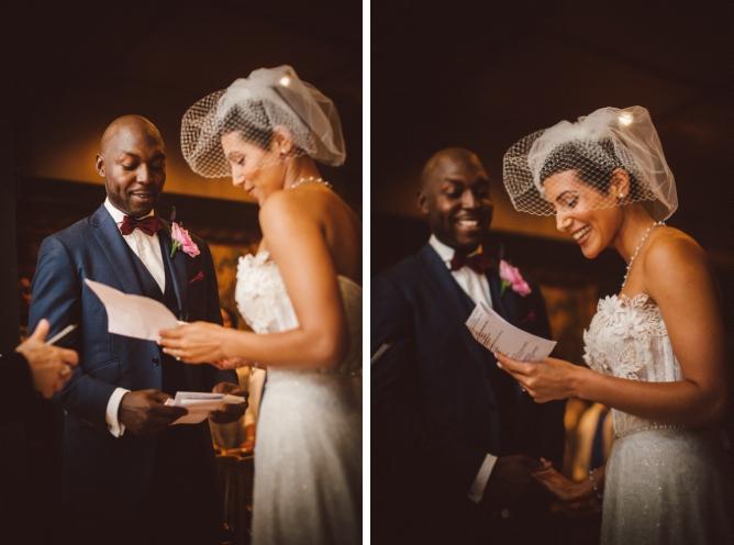 Bride with big smilereading wedding vows