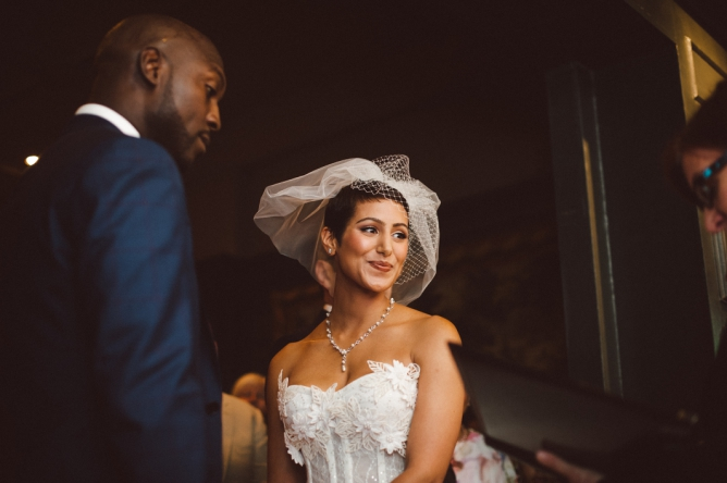 Bride with bright smile at Porchester Hall wedding in London