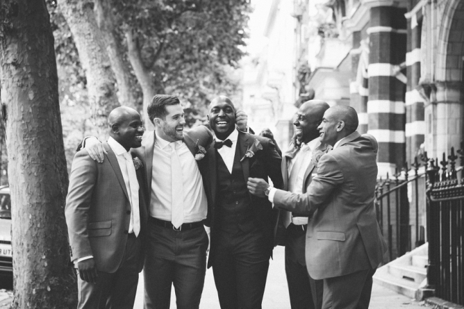Groomsmen laughing with groom outside The Gore in London