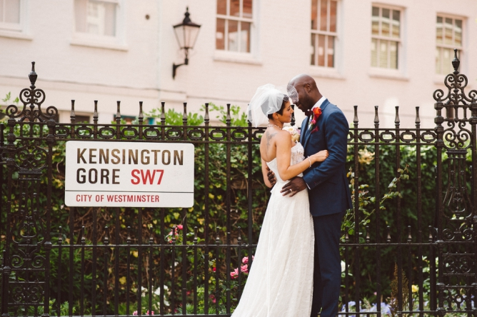 Married couple infront of Kensington road sign