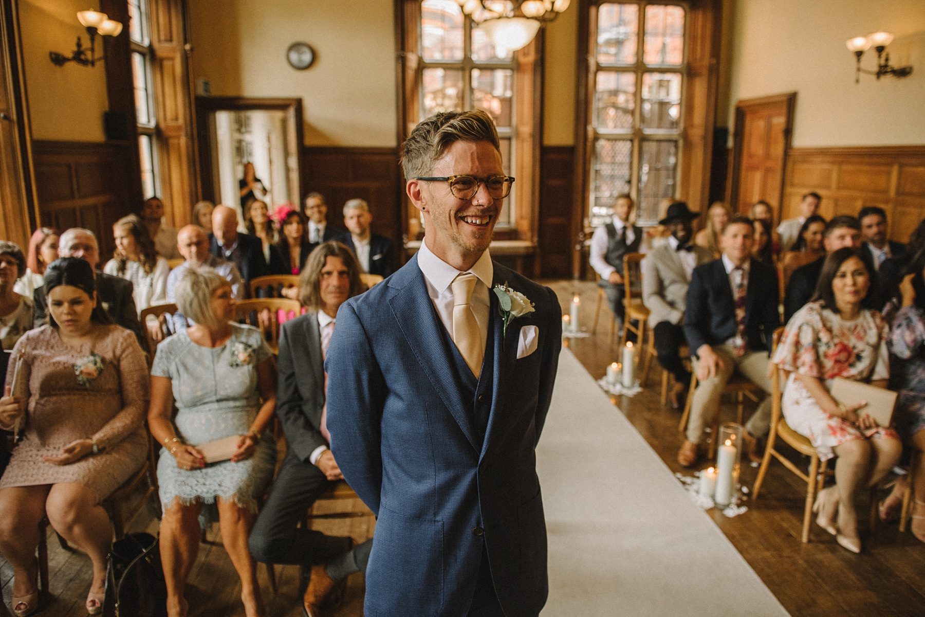 photo of groom laughing