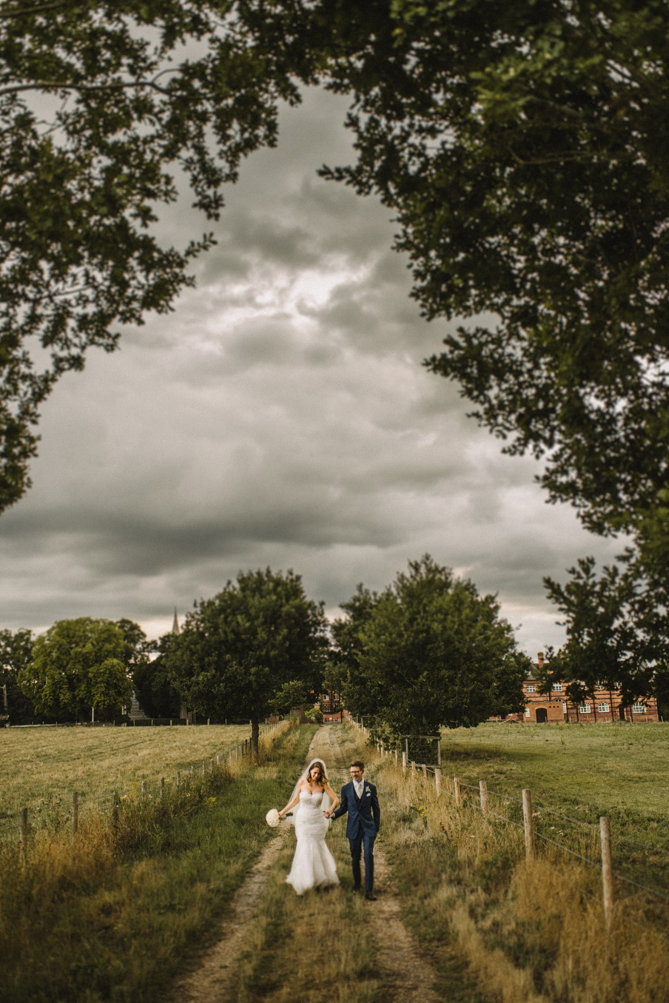 photograph of couple walking in the venue grounds