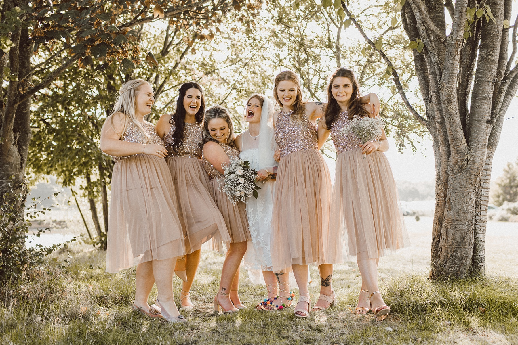 bride with her bridesmaids at the Berkshire wedding venue