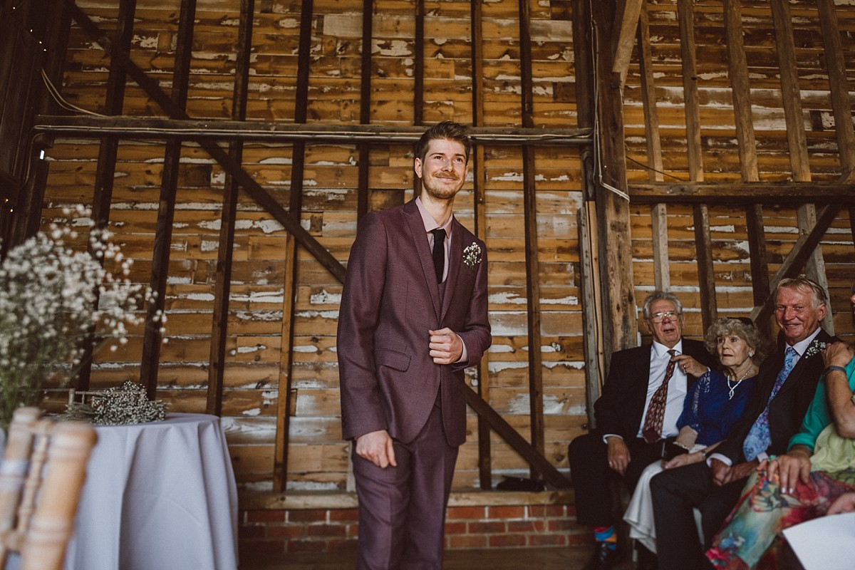 giving a speech at rustic barn wedding