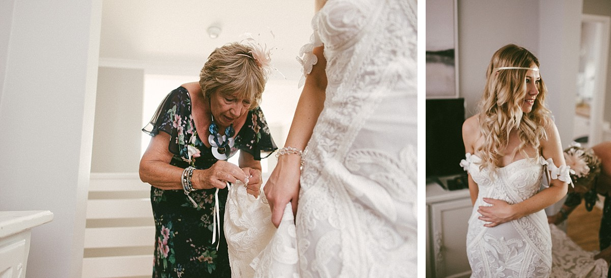 photo of mother of bride helping daughter