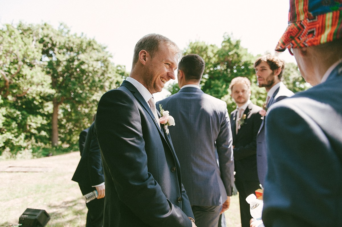 groom laughing before wedding at Hayling Island wedding venue