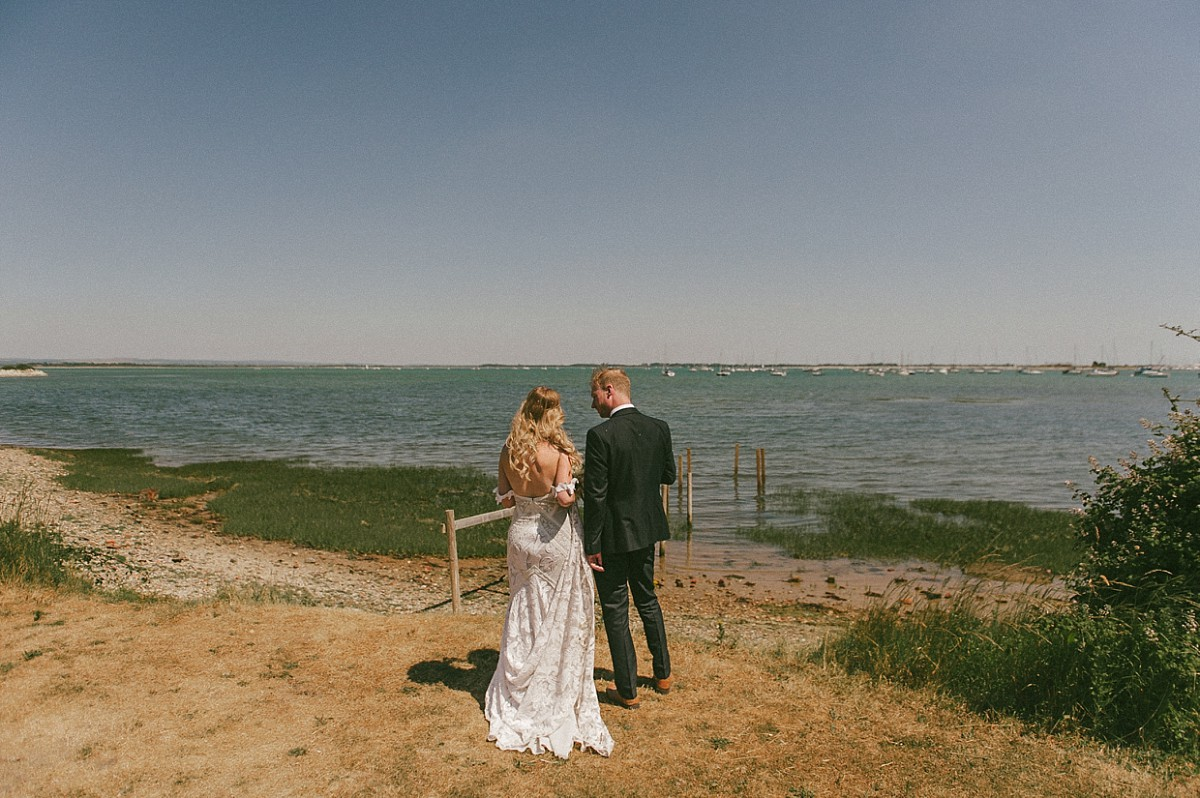 bride and groom looking out on Hayling Island