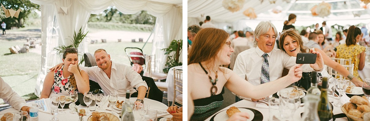 guests laughing at Hampshire marquee wedding