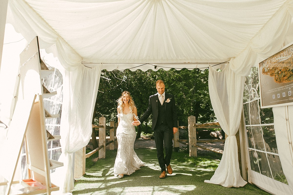 married couple entering marquee at Tournerbury Woods Estate