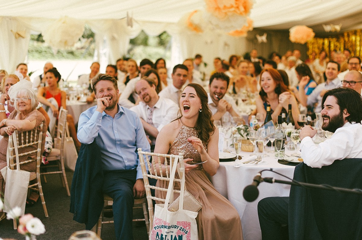 guests laughing at wedding speeches at Tournerbury Woods Estate