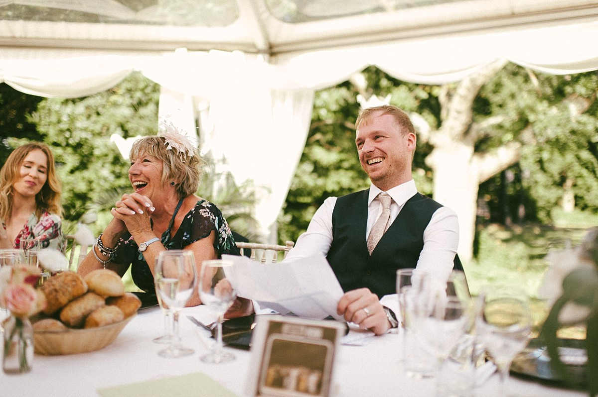 groom laughing at bride doing speech at Tournerbury Woods Estate
