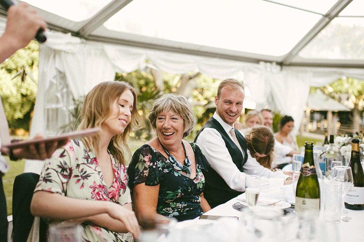 brides mum laughing at wedding speech