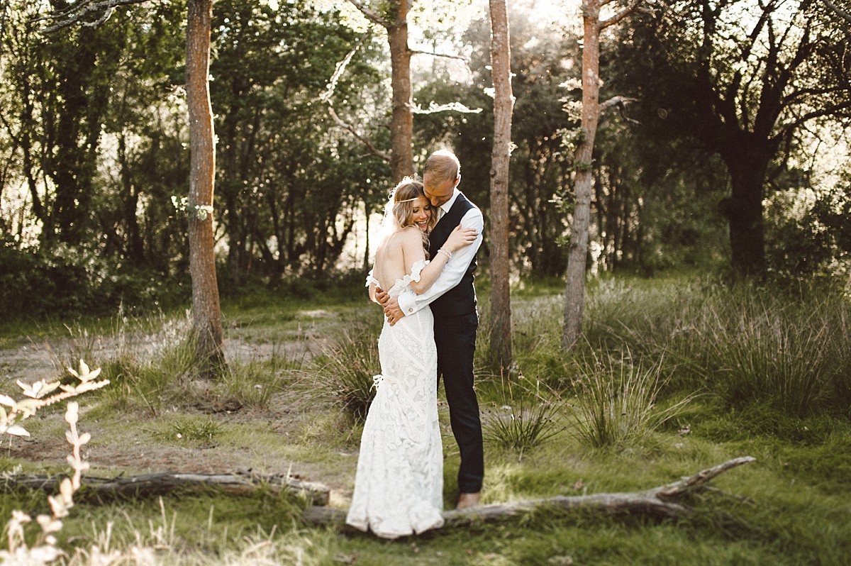 colour photo of couple in the woods