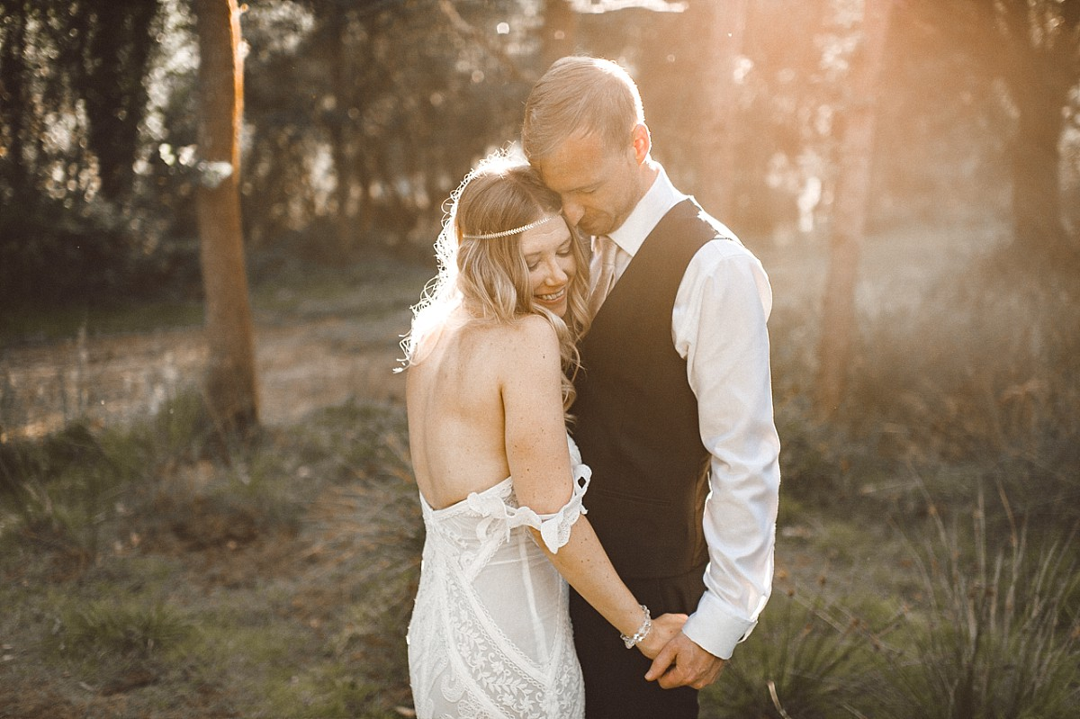 colour photograph of newly married couple in the sunset