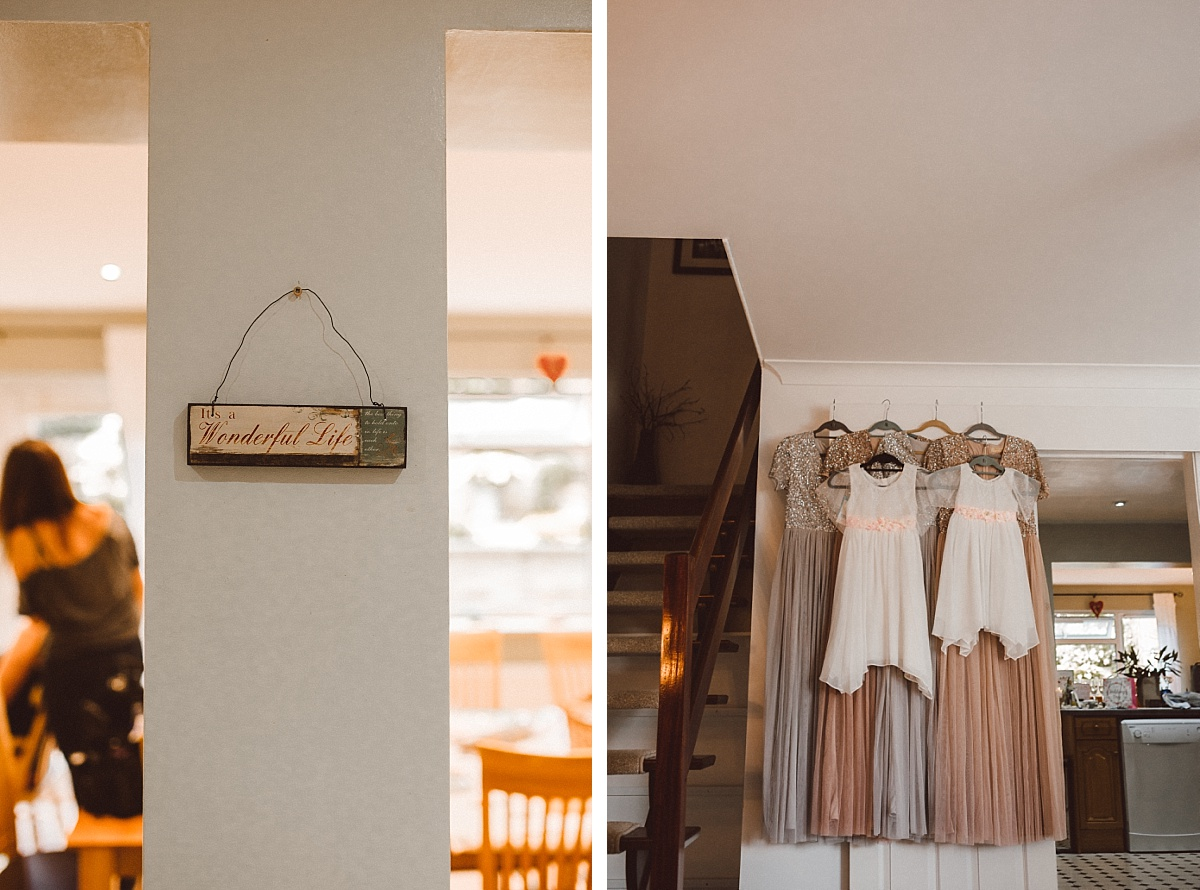 Photo of wedding dresses hung on wall