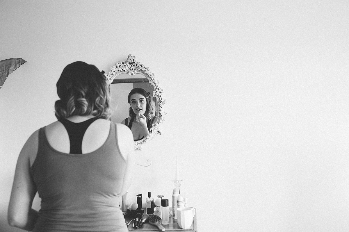 photo my matt lee of bridesmaid looking into mirror