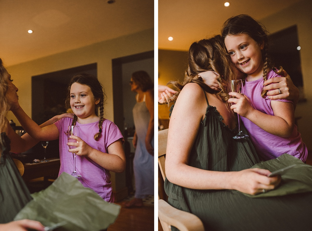 young bridesmaid giving bride to be a hug