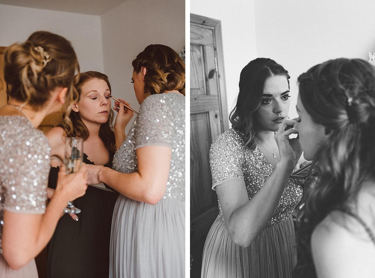 bridesmaids helping bride get ready for alternative wedding