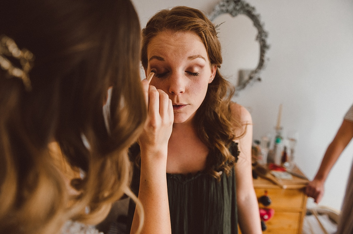 close up picture of cool bride having her makeup done for alternative wedding