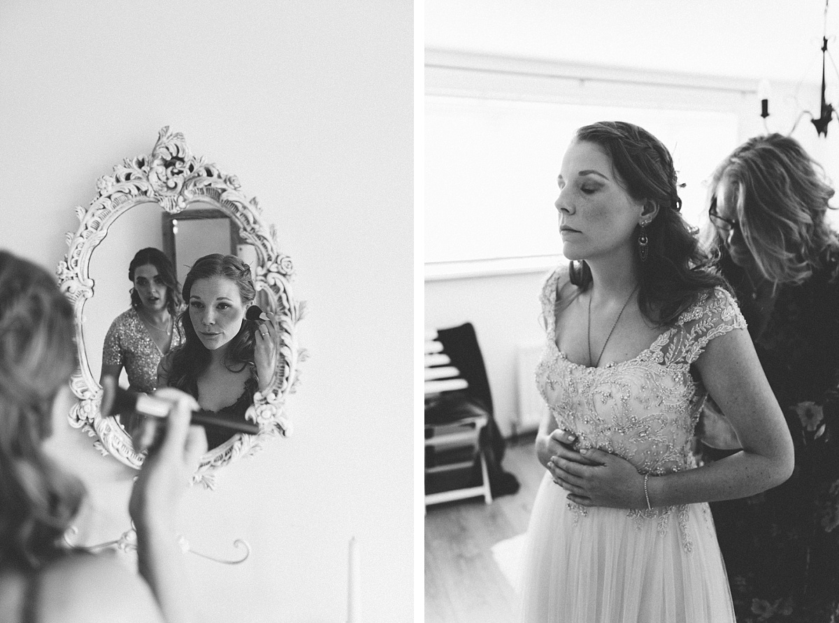cool bride looking in mirror getting ready for her alternative wedding