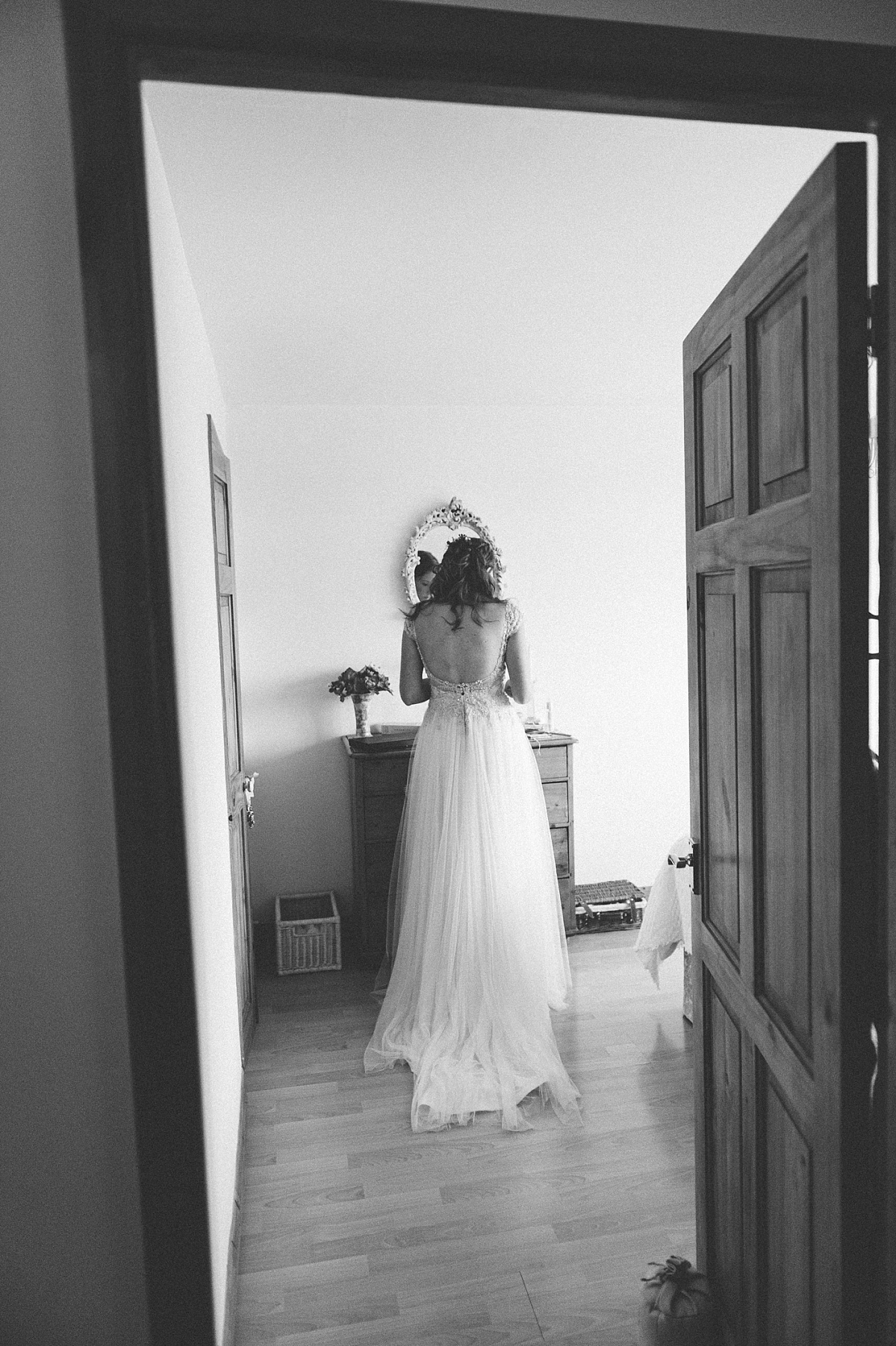 black & white photo of Bride getting ready for her alternative wedding
