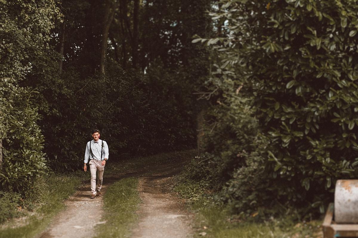 Bestman at wedding walking down lane