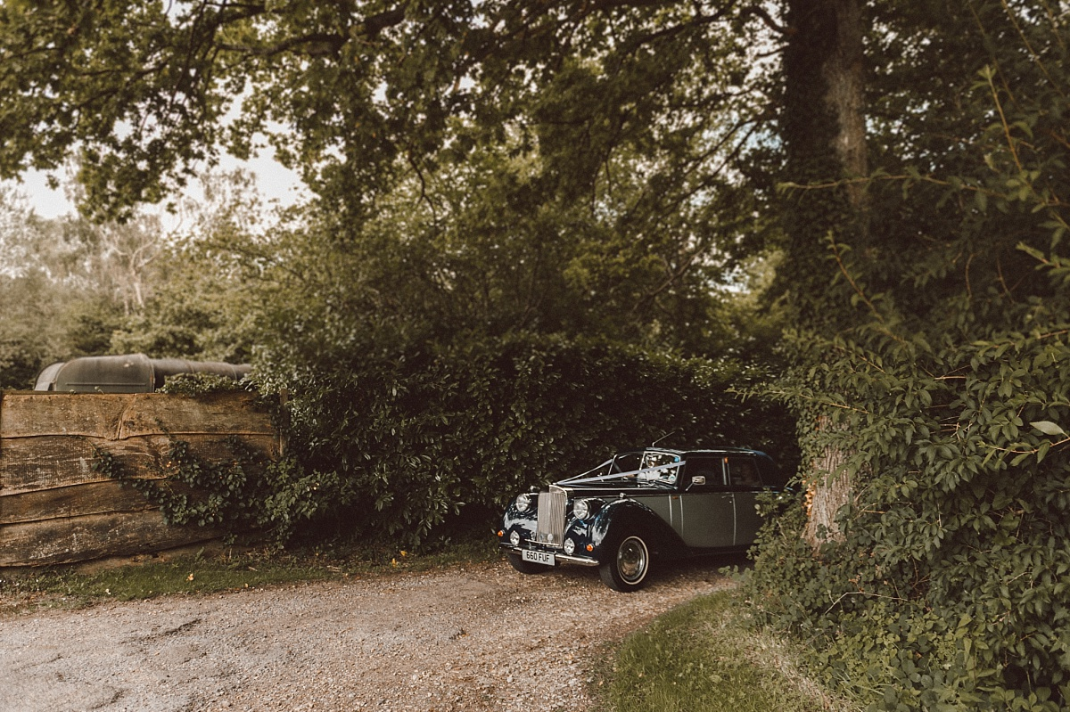 Classic wedding car arriving at wedding venue in Hampshire