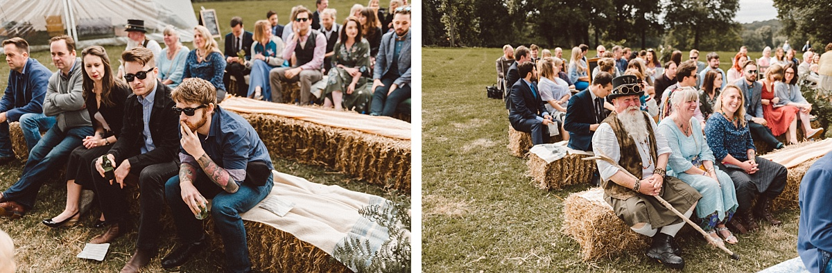 wedding guests sitting on hay bales at outdoor wedding