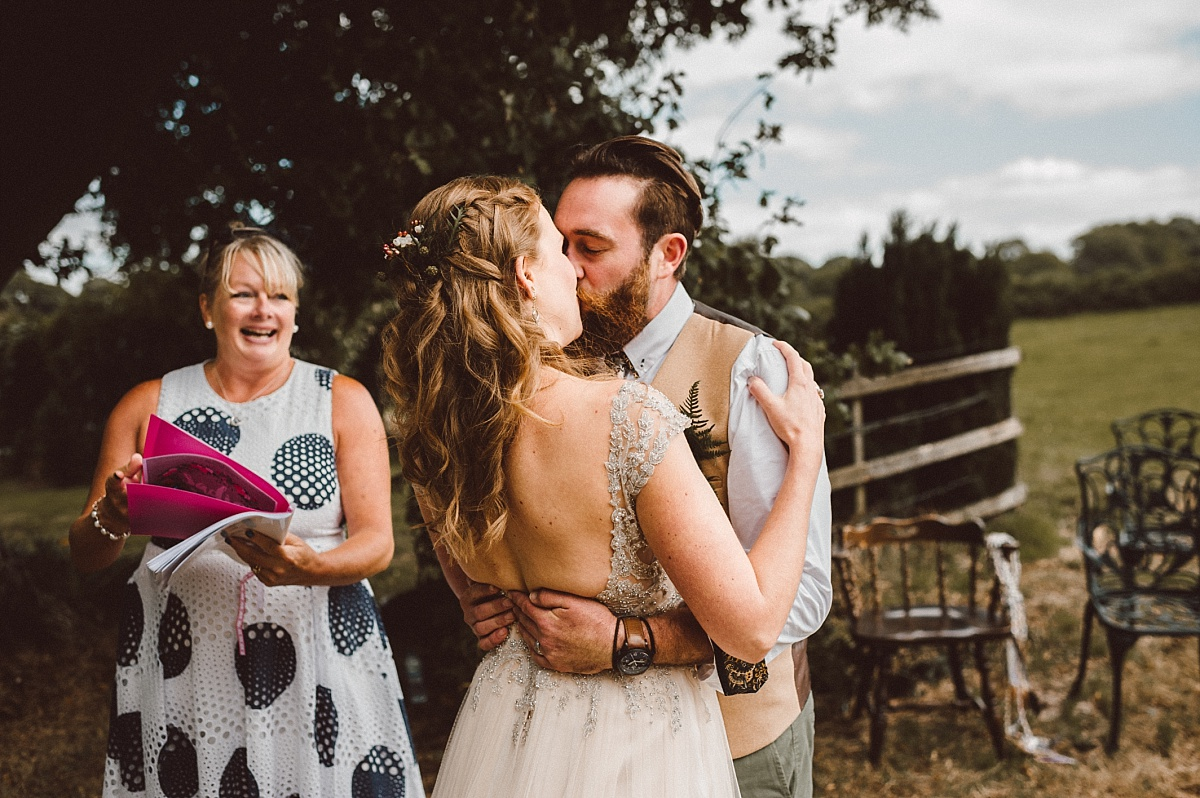 Couple having first kiss after saying I do