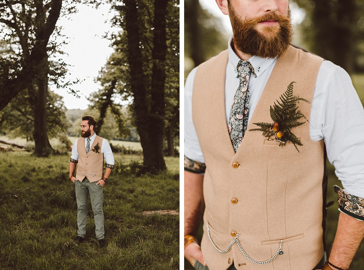 Cool hipster Groom standing in field under the trees