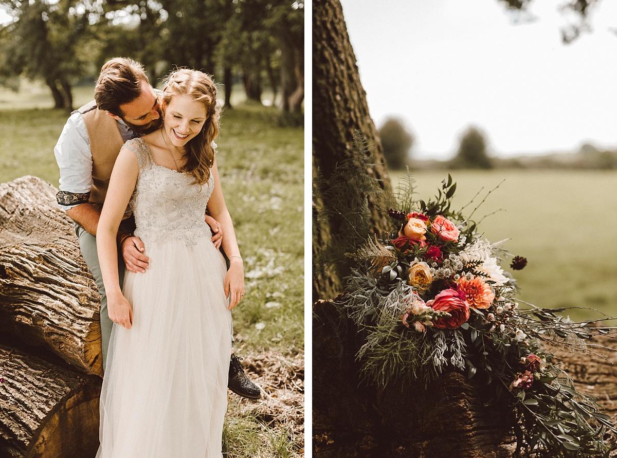 Photo of rustic wedding bouquet on logs in field