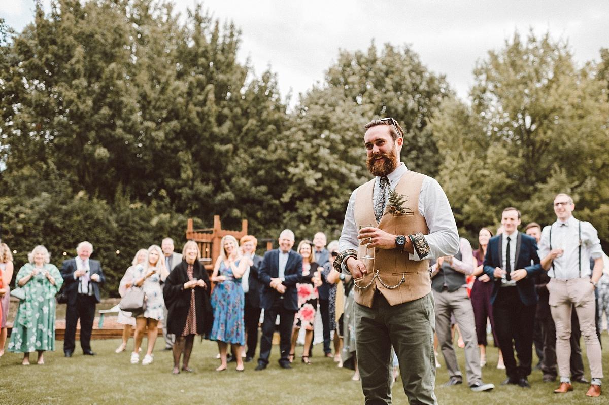 Groom watching bride singing during alternative wedding