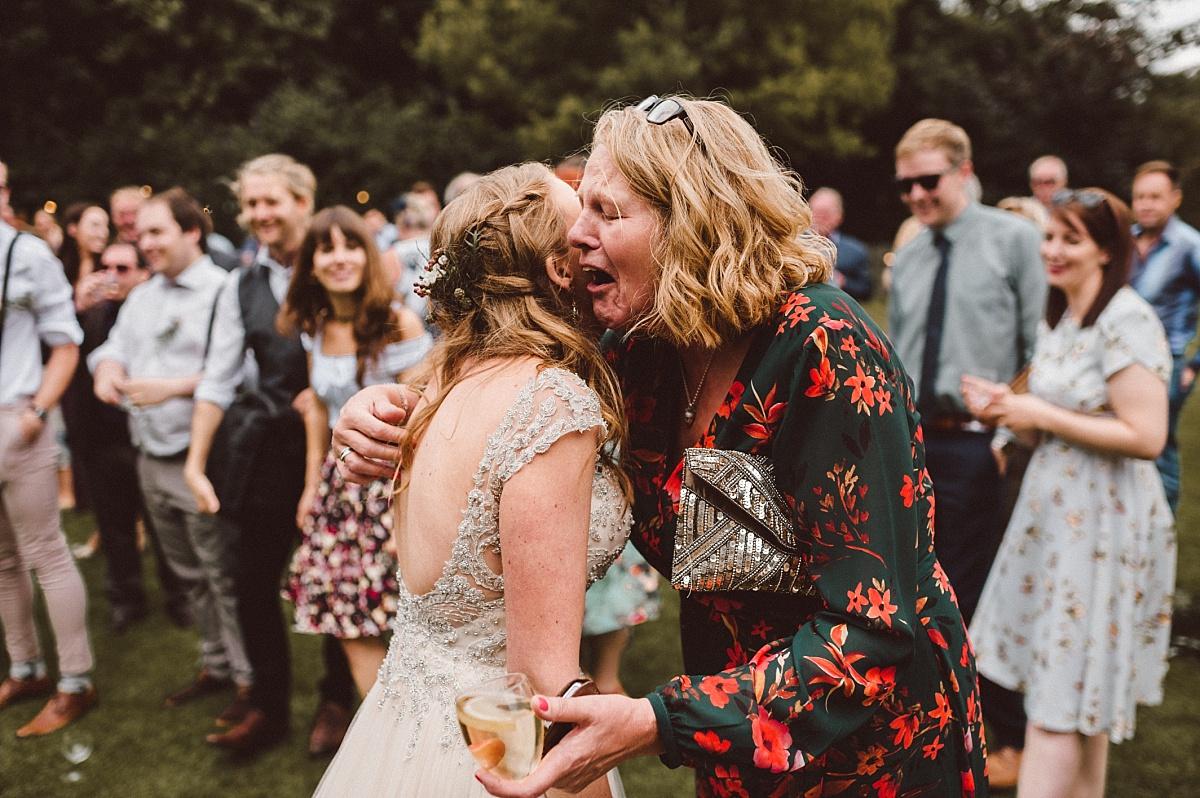 Mother of Bride hugging daughter