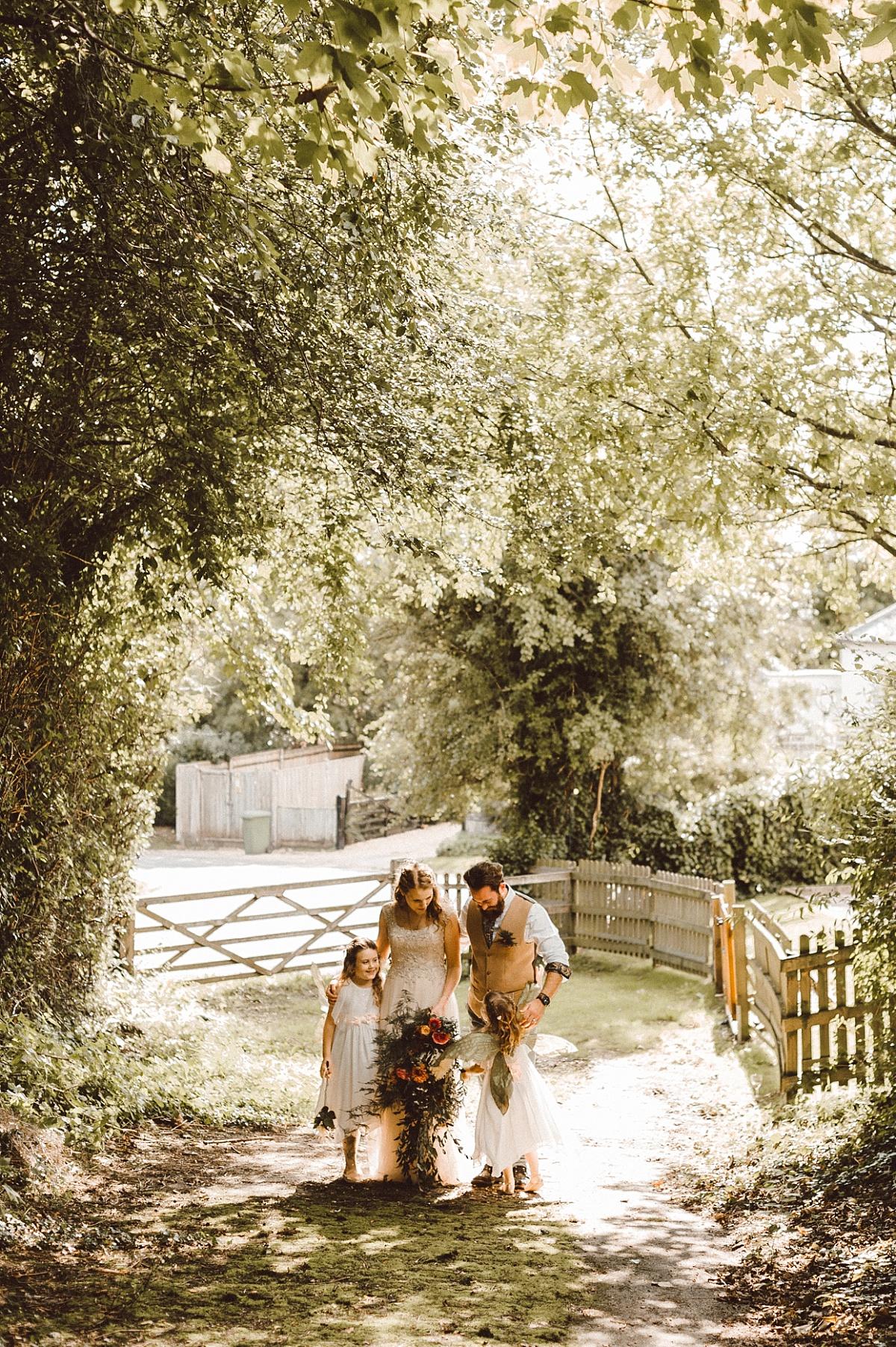 Photo of cool BoHo couple at alternative wedding
