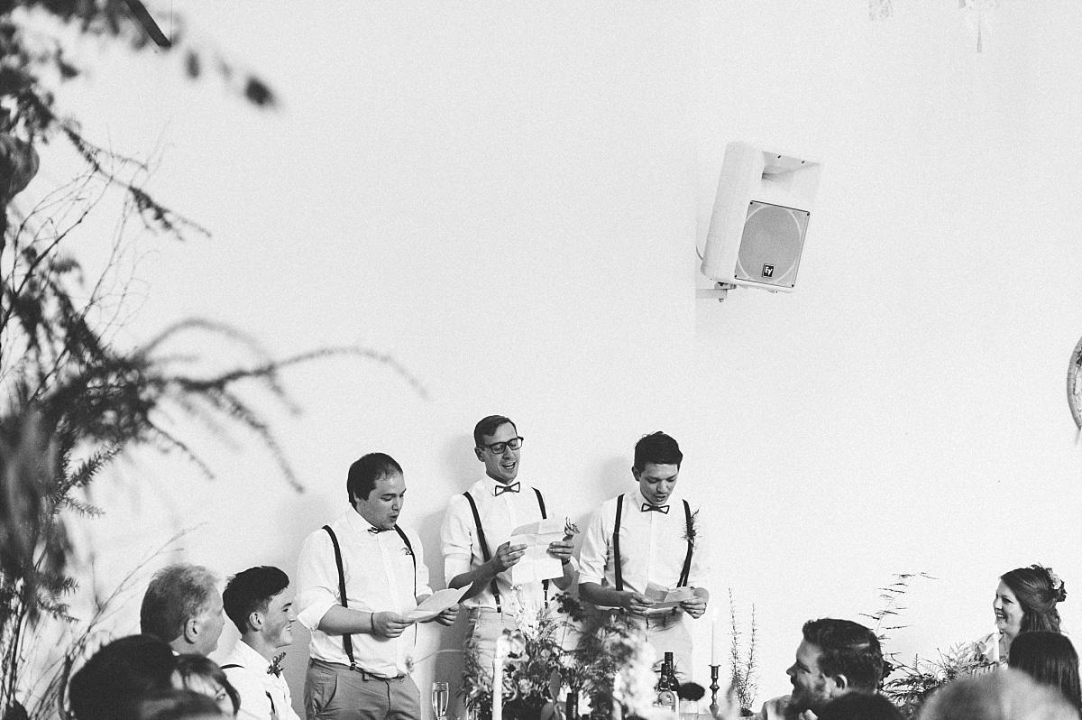 Groomsmen giving bestman speech