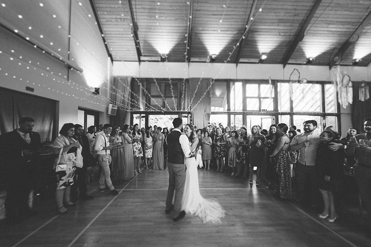 Wide angle photograph of First dance at alternative wedding