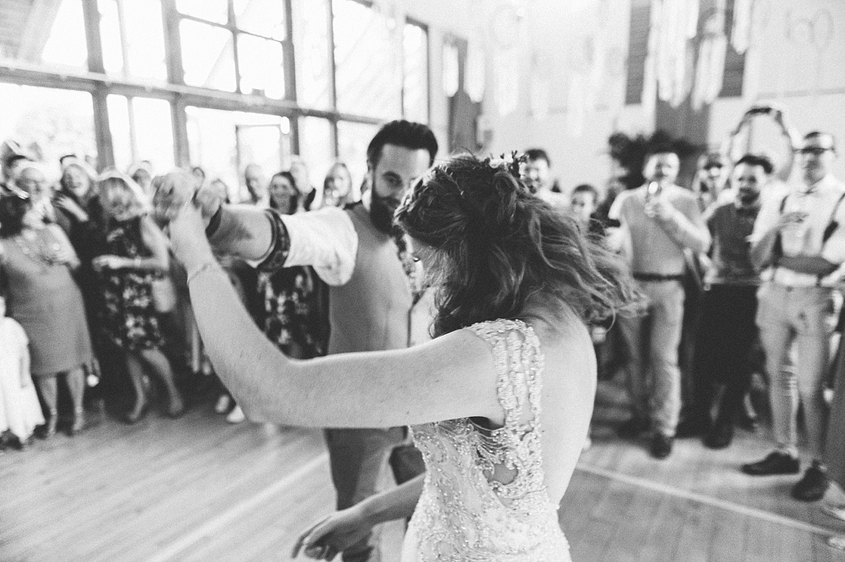 Black & white photo of Boho couple doing first dance
