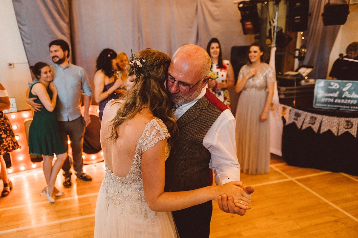 Bride dancing with dad at alternative wedding