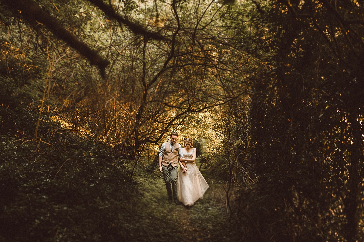 Bride and groom surrounded by lots of branches