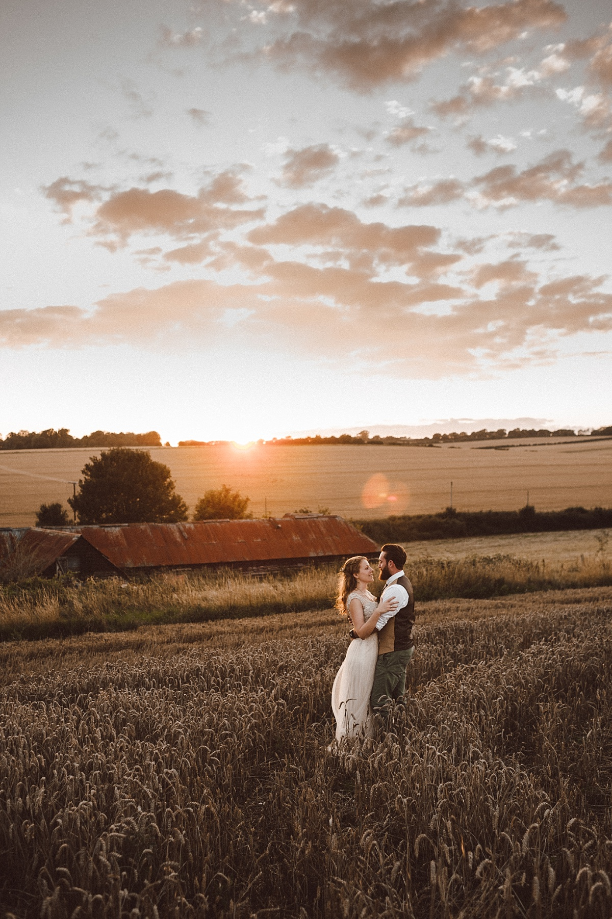 photo of couple in field at alternative wedding