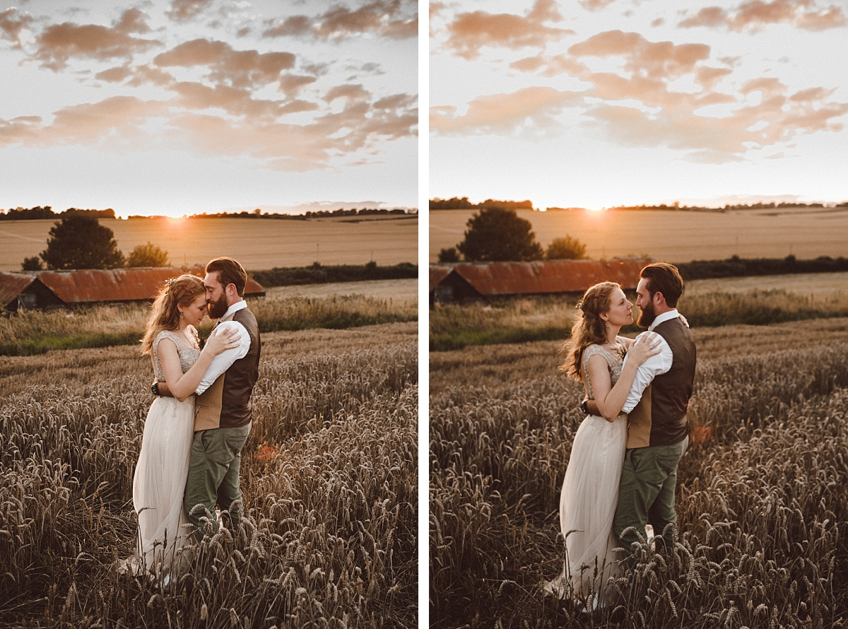 BoHo couple holding eachother with sunset behind