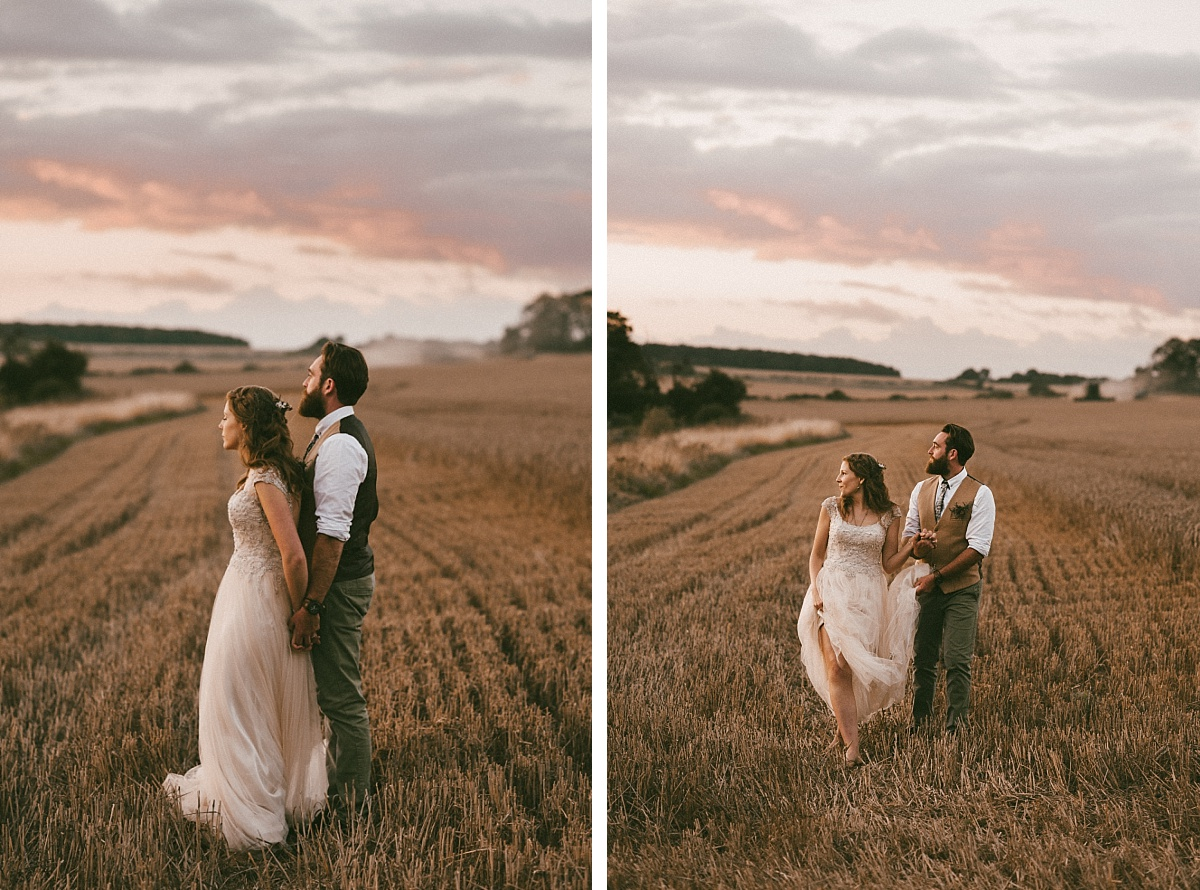 couple in field at alternative wedding