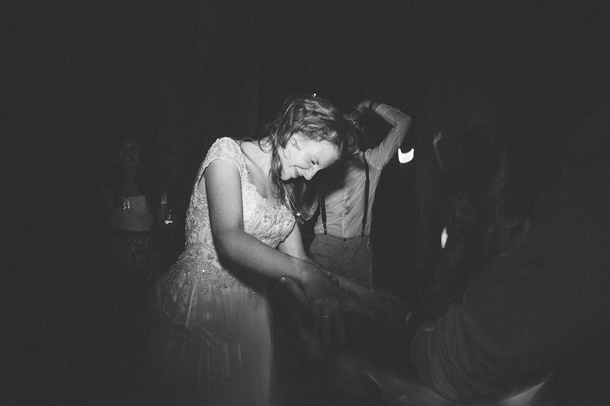 Bride having lots of fun at wedding reception
