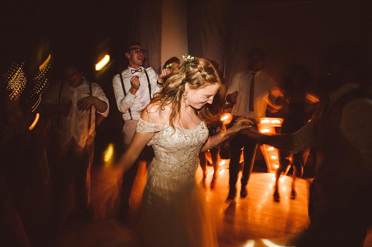 Bride dancing with wedding friends