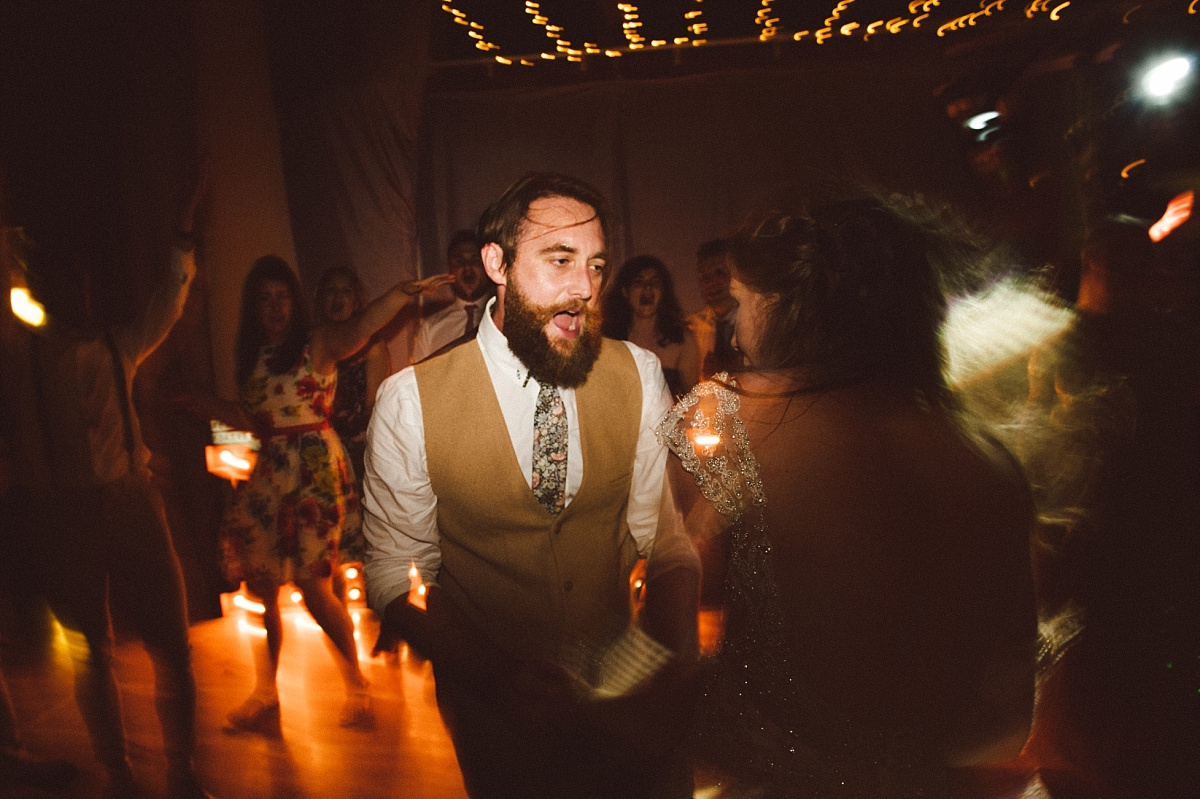 Photo of druck Groom dancing at alternative wedding