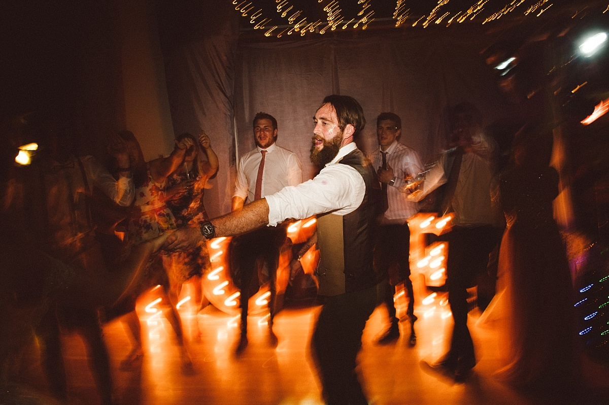 Groom dancing with bride on wedding day