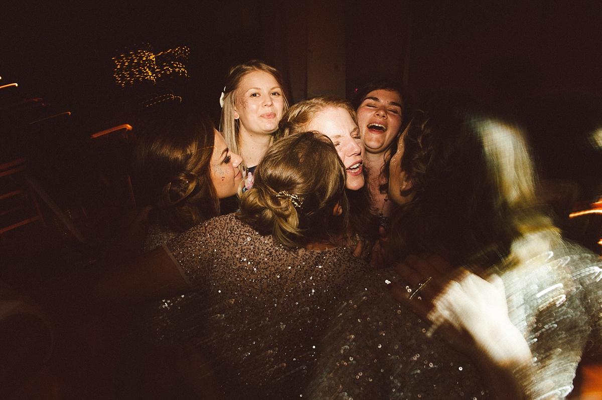 Brides maids kissing happy Bride