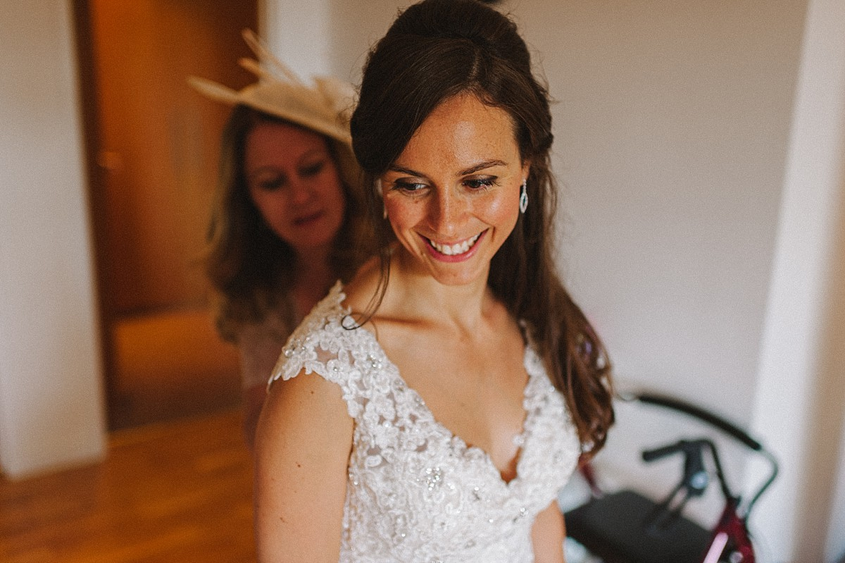 smiling bride getting ready on wedding day